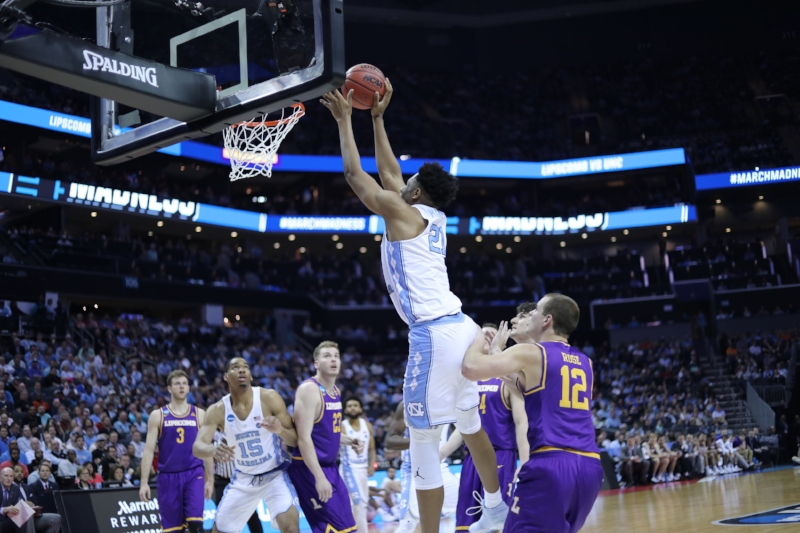 Manley goes up for a dunk against Lipscomb in the 2018 NCAA tournament. | Photo by Caleb Jones