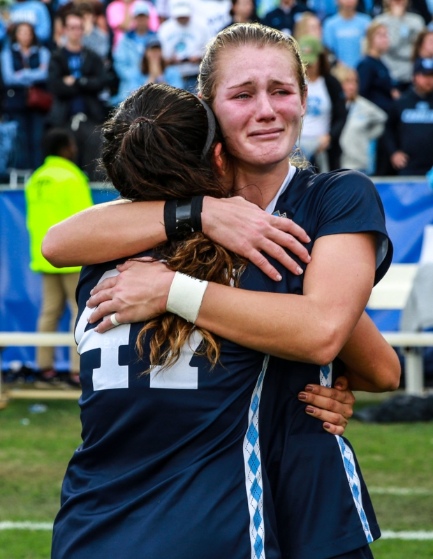 Senior Alex Kimball embraces redshirt-sophomore Taylor Otto after the final whistle. The 2019 senior class became just the third senior class ever at UNC to graduate without a national title.   Photo by Alex Kormann