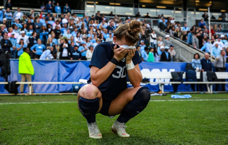 Sophomore Brooke Bingham takes a moment just after the final whistle of UNC's 1-0 loss to FSU in Sunday's national title game.   Photo by Alex Kormann