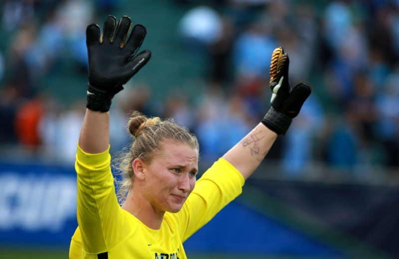 Senior goalkeeper Samantha Leshnak thanks the crowd after Sunday's national title game. WakeMedSoccer Park was filled with Tar Heel faithful, who Leshnak revved up throughout the game.   Photo by Alex Kormann