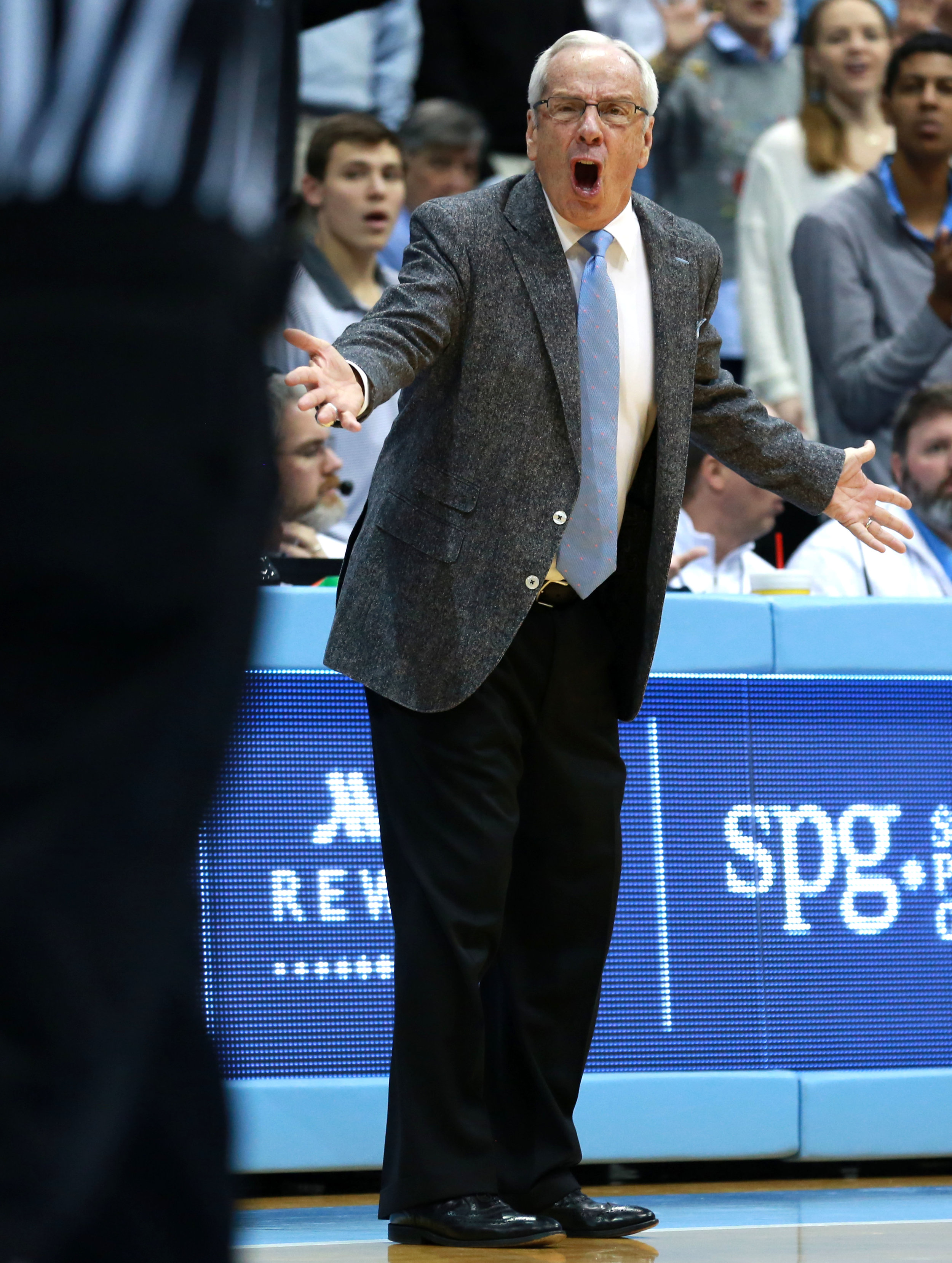 Roy Williams attempts to get a referee's attention during Saturday's loss to Louisville. The Hall of Fame coach suffered his worst home defeat of his Carolina head coaching career against the Cardinals. | Photo by Alex Kormann