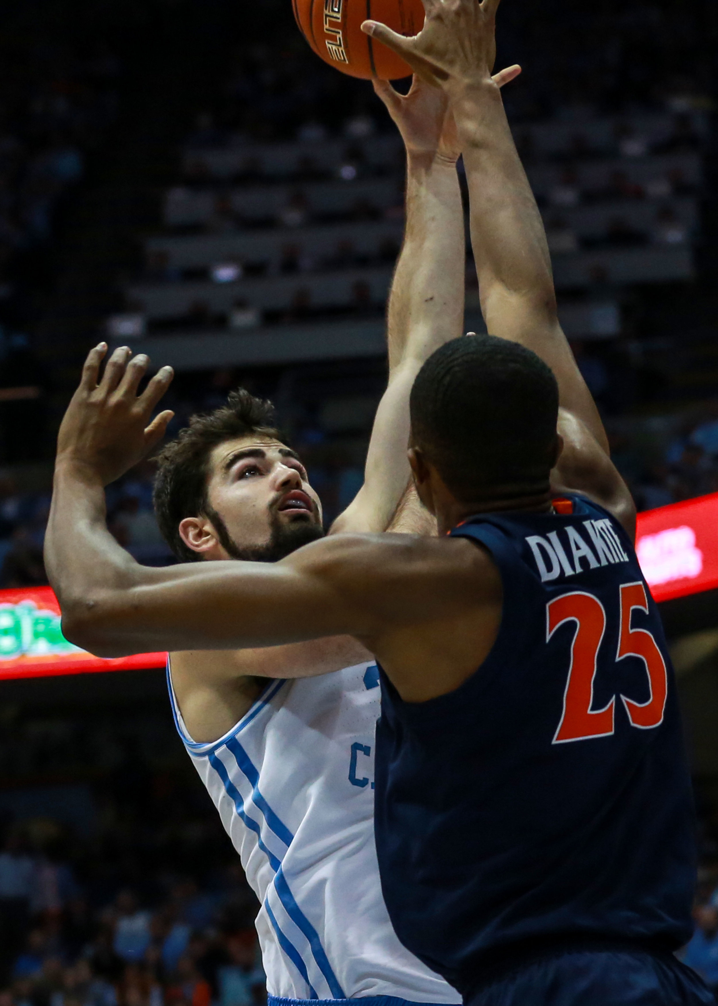 Luke Maye goes up for a shot against UVA's Mamdi Diakite. The senior forward struggled against the Cavaliers, scoring just four points on 2-of-10 shooting. | Photo by Alex Kormann