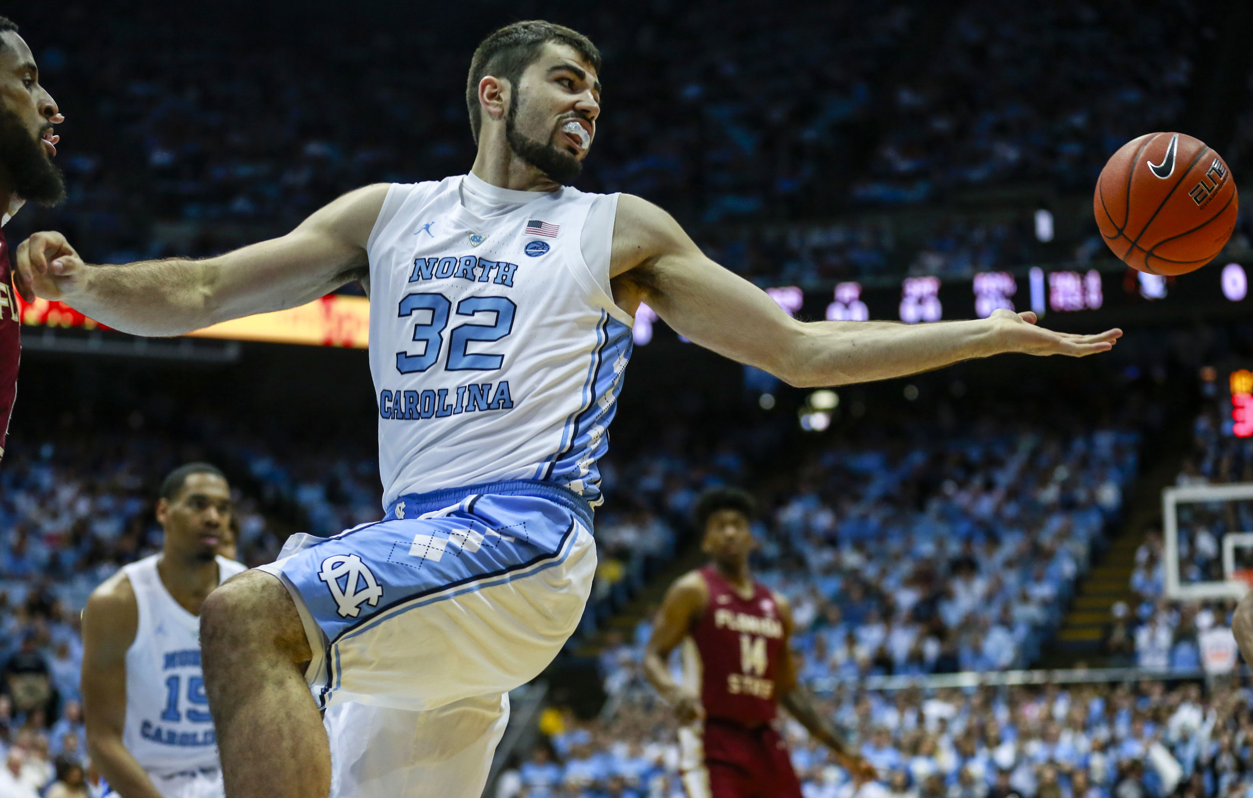 Luke Maye fights to secure a rebound during UNC's win over FSU. The senior forward finished the afternoon with 13 points and 11 rebounds, his 11th double-double of the season. | Photo by Alex Kormann