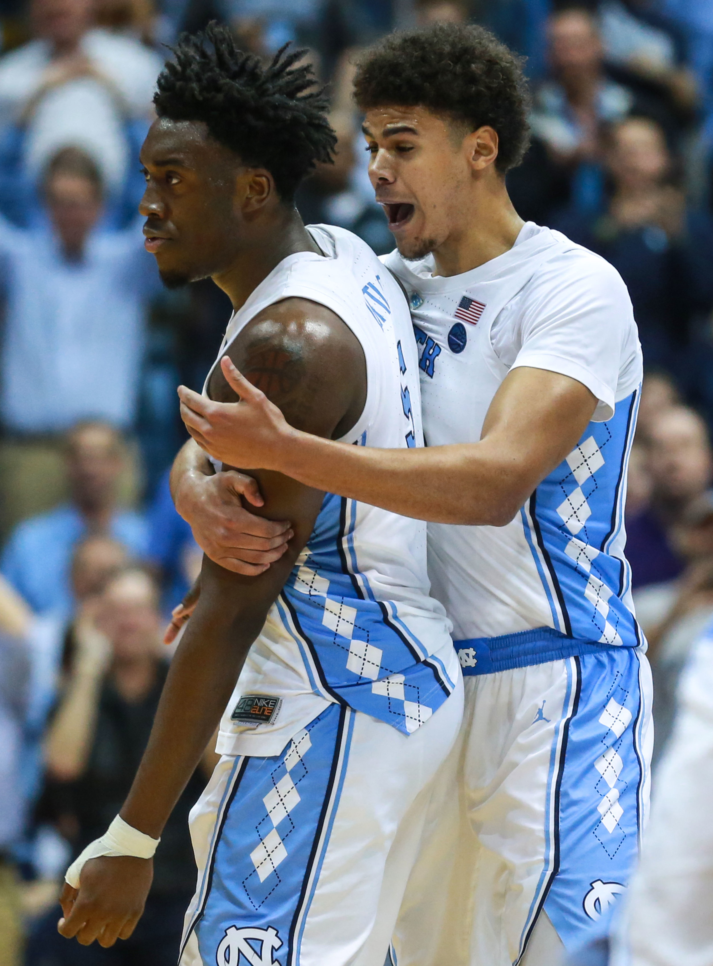 Cameron Johnson hypes up Nassir Little after an And-1 bucker during UNC's win over FSU. The graduate transfer and freshmen tied for the lead in points for UNC, each bringing in 18 over the course of the afternoon. | Photo by Alex Kormann