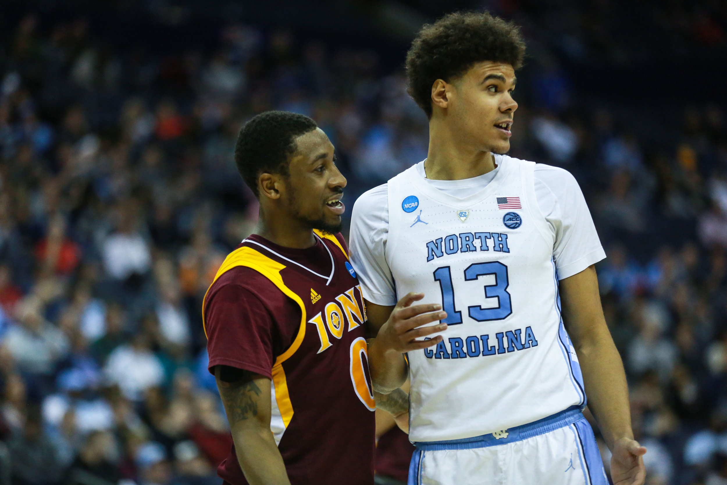 Cameron Johnson is guarded by guard Rickey McGill during UNC's win over Iona. The graduate transfer led UNC in scoring with 21 points, including a 4-of-8 effort from three. The Tar Heels are 15-0 when Johnson scores three of more three pointers in a game this season. | Photo by Alex Kormann