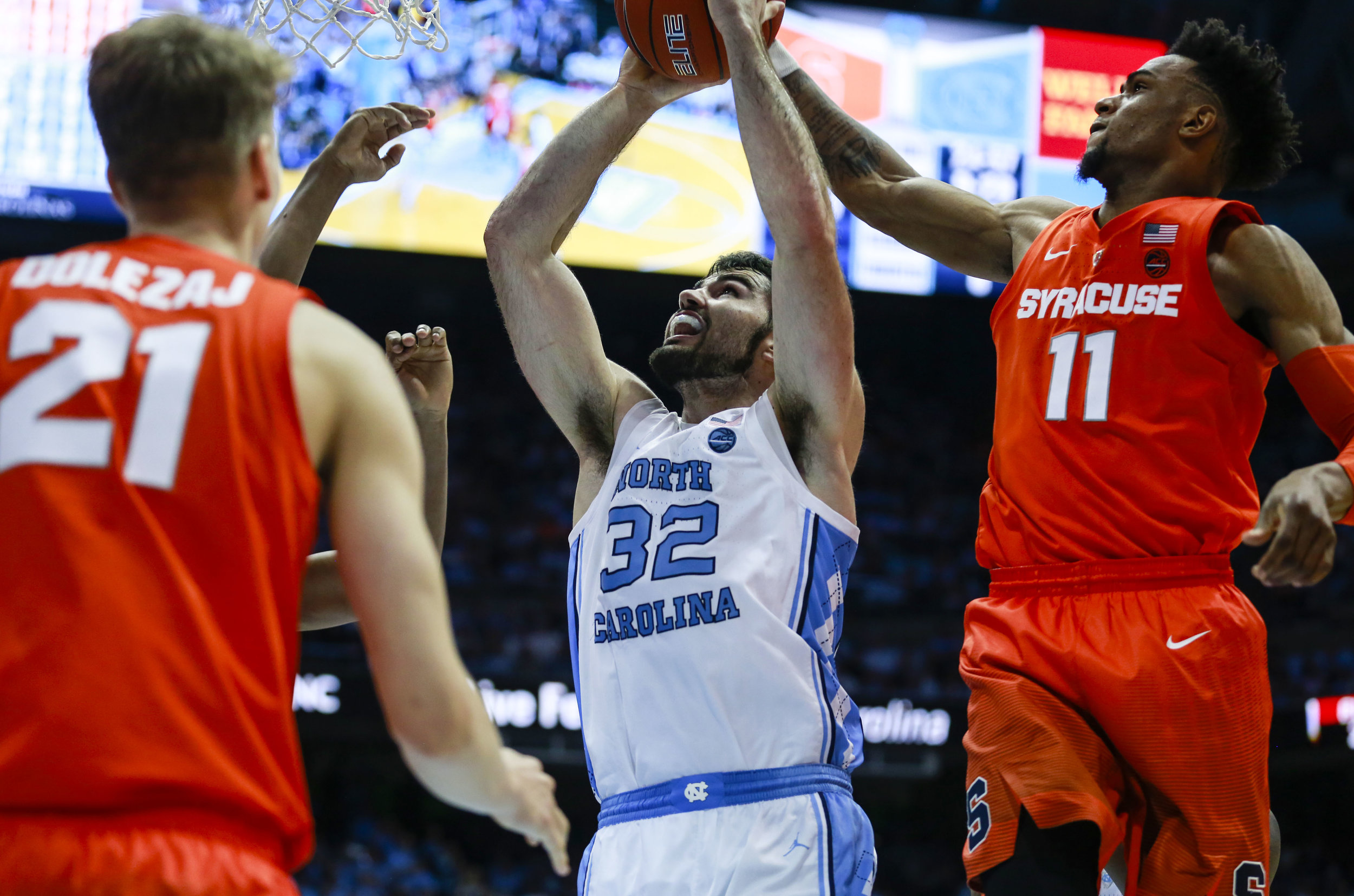 Getting inside against a zone is key. Here, Luke Maye goes up for two of his nine points against the Orange in a February win. | Photo by Alex Kormann