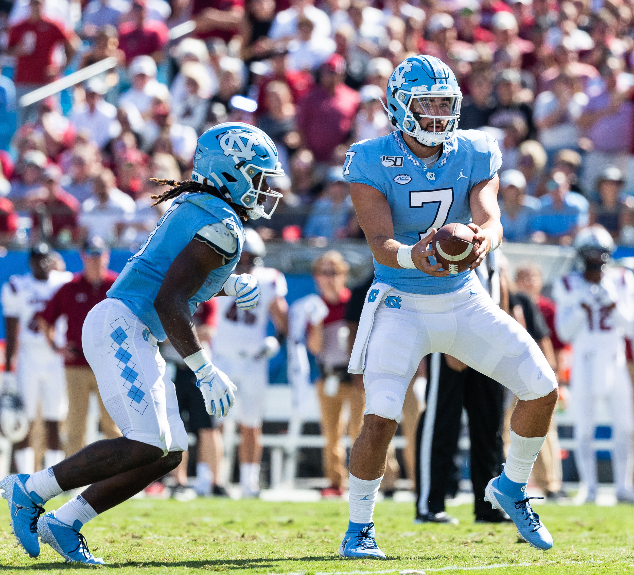 Sam Howell and a deep rushing attack led UNC in Charlotte.  Photo by Smith Hardy