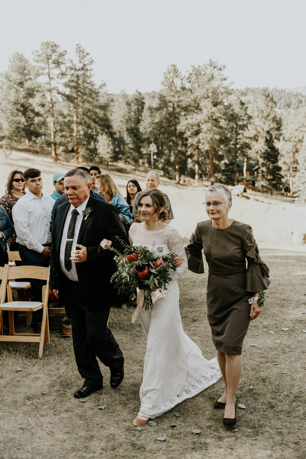 Intimate Mountain Wedding Bride Walking down the aisle Photos in Meadow Creek, Pine Colorado