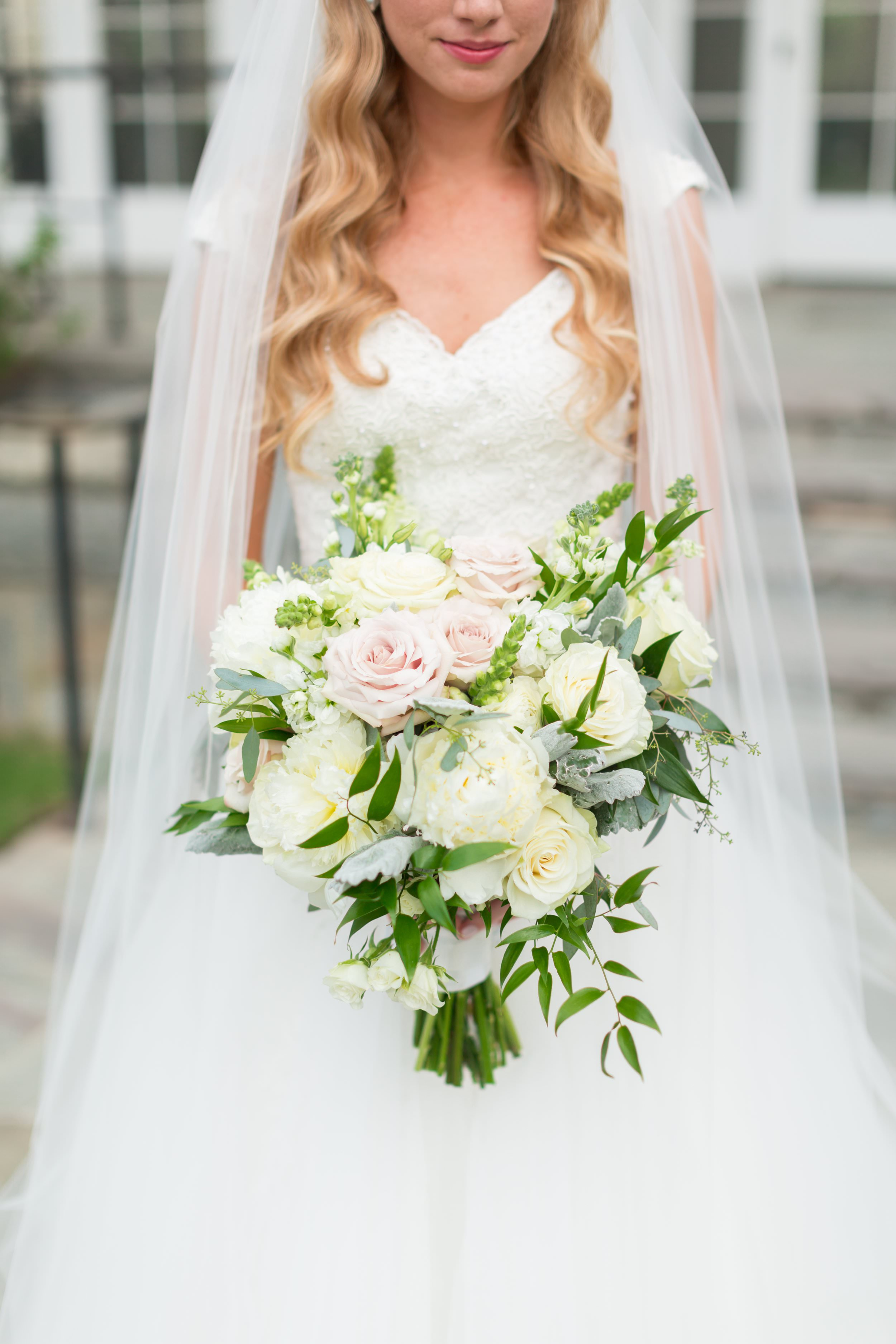 This blush and white bouquet by  Atlanta wedding florist Tulip Blooming Creations makes me swoon! It feels like she's carrying an English garden in her hands. To view more from Mac and Brittney's  Piedmont Driving Club wedding, click here .