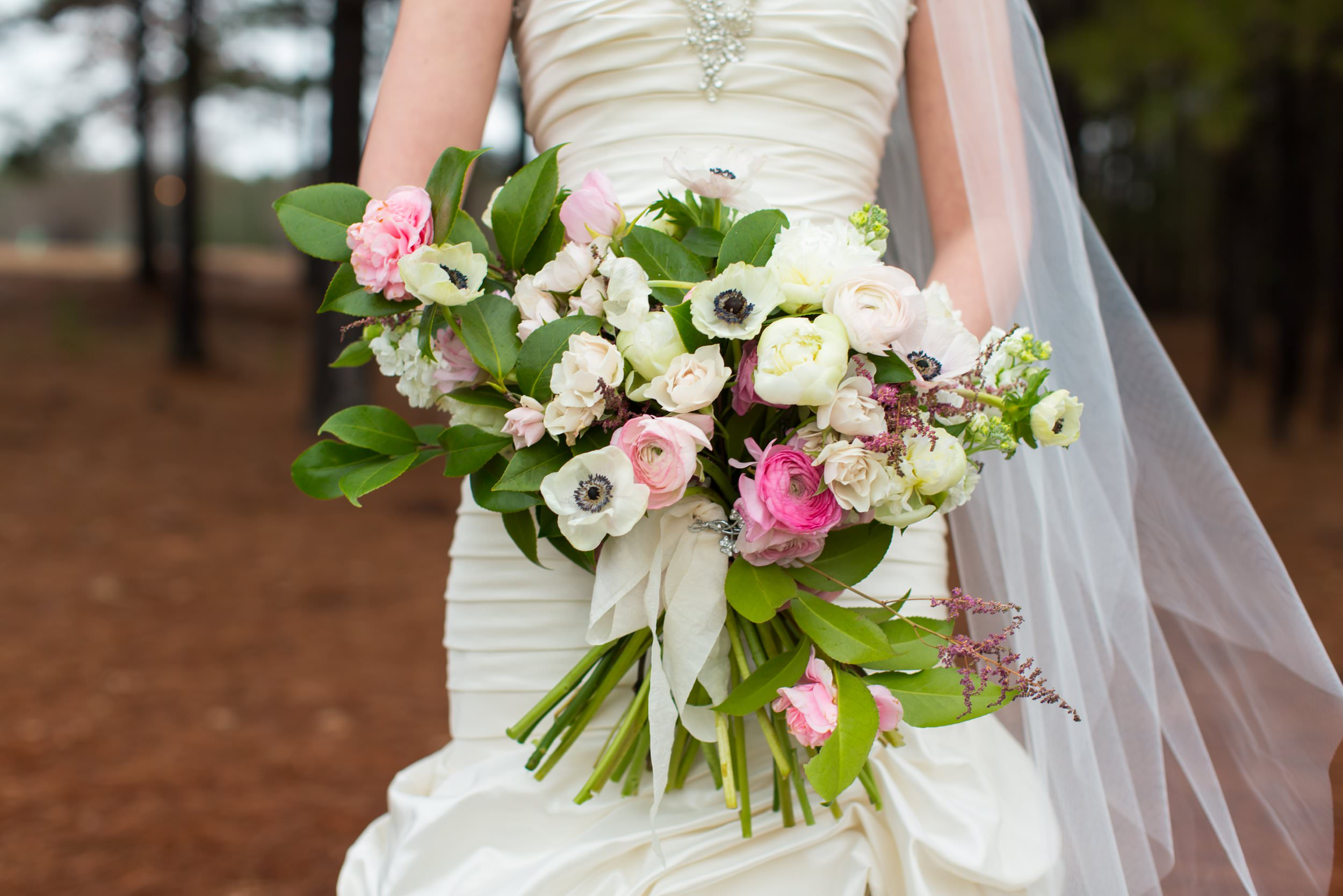 Danielle's asymmetrical bridal bouquet by  Atlanta florist Forage and Fleur  was oh so lovely. I especially love the anemones!  Click here  to view more photos from Steven and Danielle's  Eagles Brooke Country Club wedding .