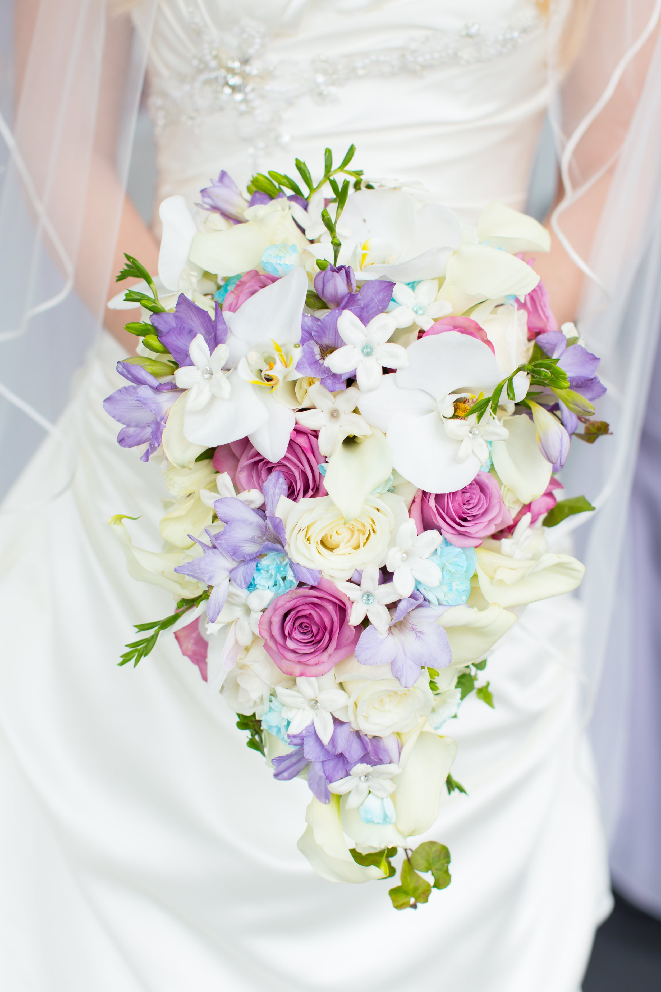 Amber's classic cascading bouquet by  Sharpsburg florist Bedazzled Flower Shop  was designed to mimic the style of the bouquet her mother carried when she got married. To view more from Joseph and Amber's  Something Special wedding in Newnan, click here .
