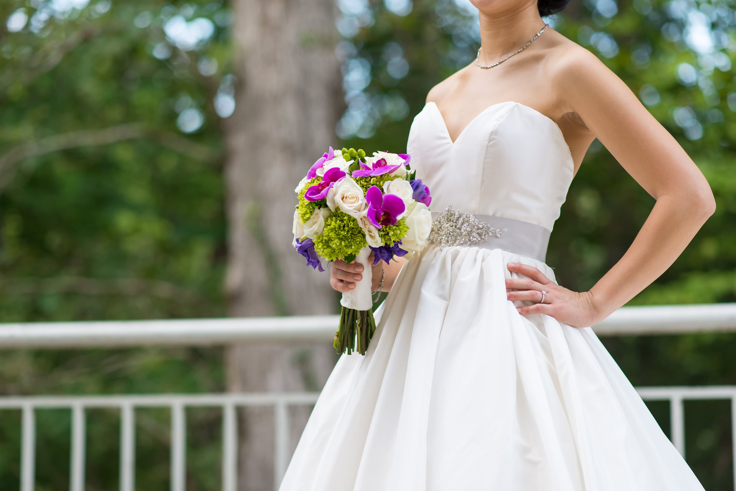 Monica's vibrant rose and orchid bouquet was the perfect contrast to her simple, elegant wedding gown. To view more jewel toned inspiration from this  Fernbank Museum wedding, click here .