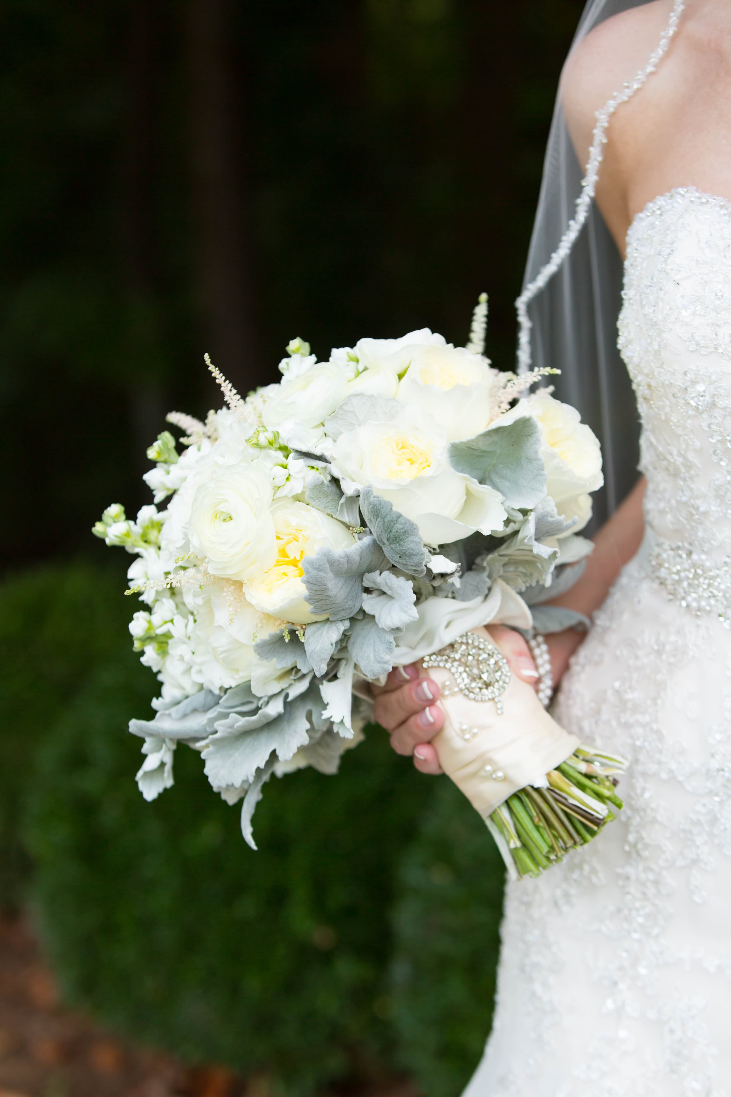 Sage and white bridal bouquet by Atlanta wedding florist  Alpharetta Flower and Garden Market . If you love this bouquet, you have to take a look at the rest of the details from her  timeless Southern wedding at the Country Club of the South .