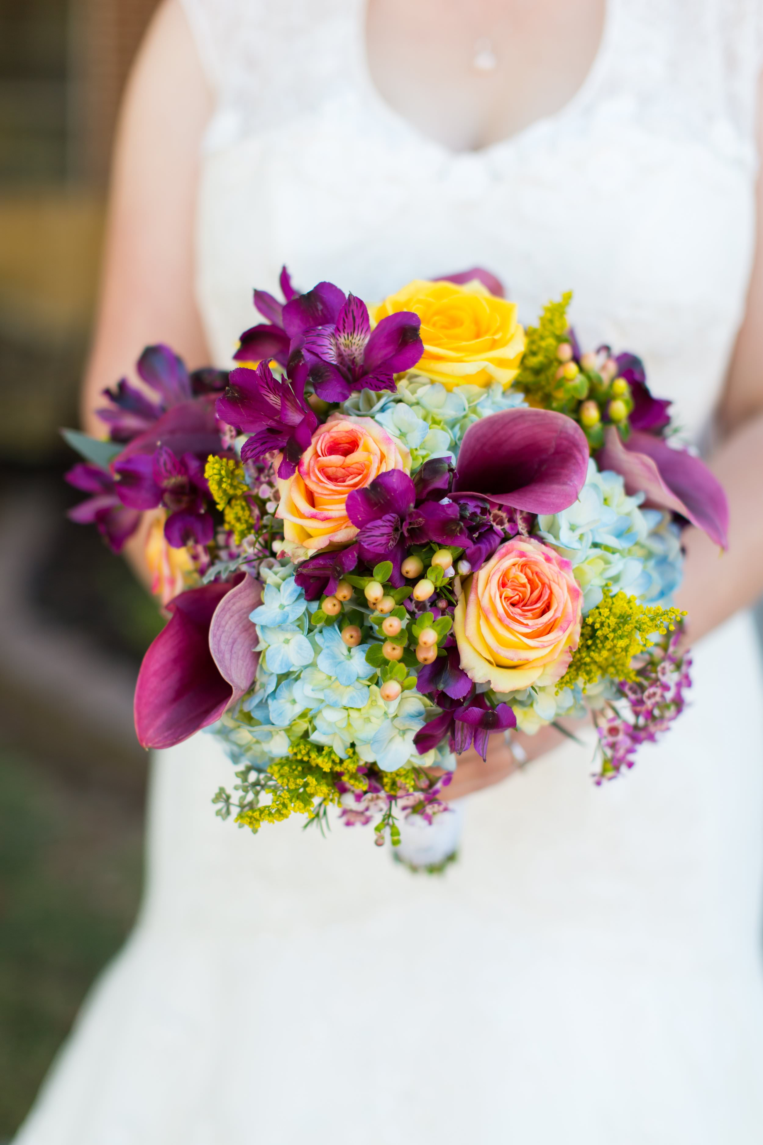 Katie's vibrant bouquet by  Atlanta florist Acorn Home & Garden  was the perfect fit for her plum and gold wedding. To view more from Andy and Katie's  Powder Springs wedding, click here .