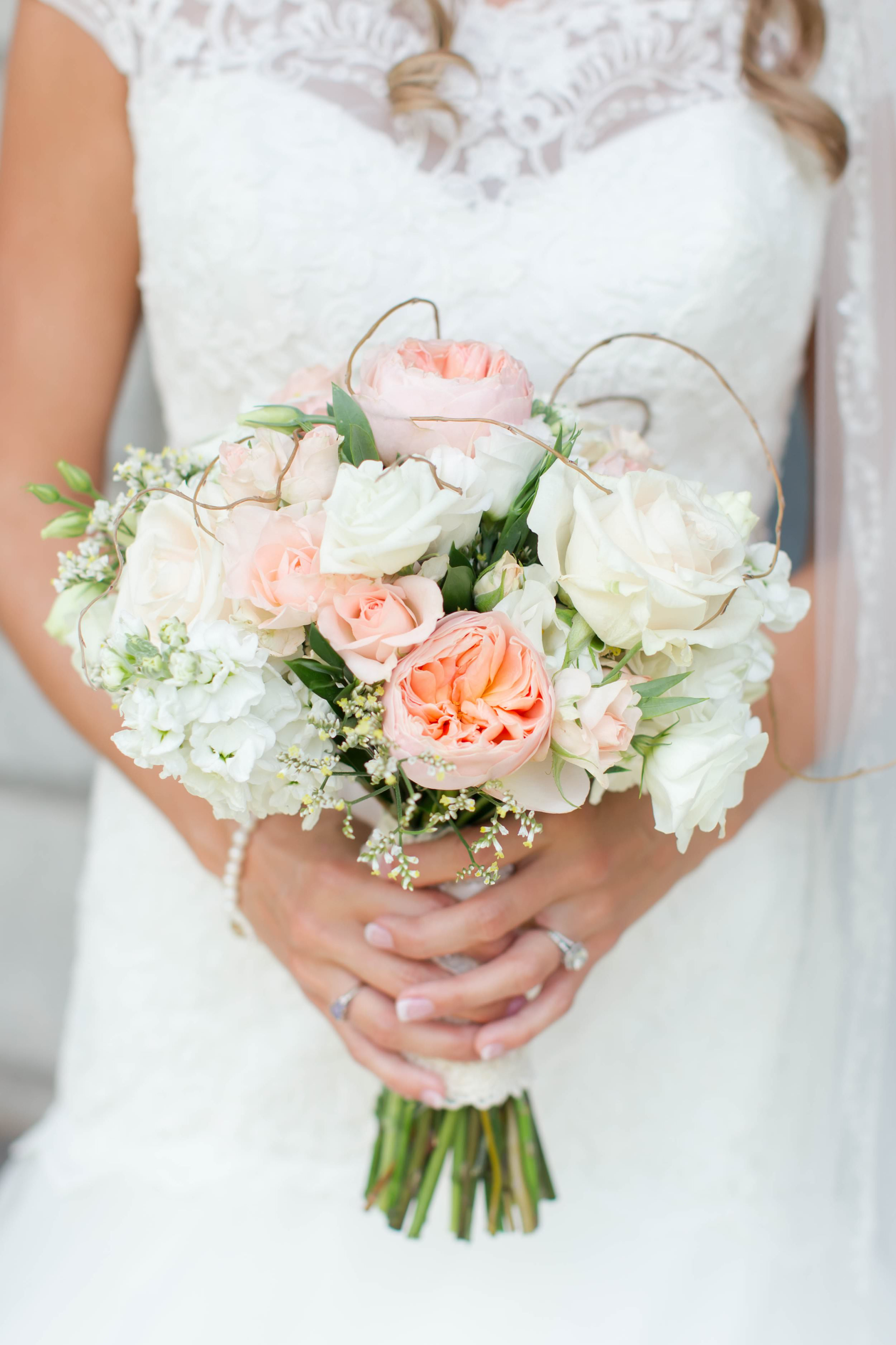 The peach garden roses in Abby's bouquet give the design sophisticated Southern charm. Her bouquet was designed by  Atlanta floral designer Faith Flowers . Visit their blog post to view more  Foxhall Wedding Photos .