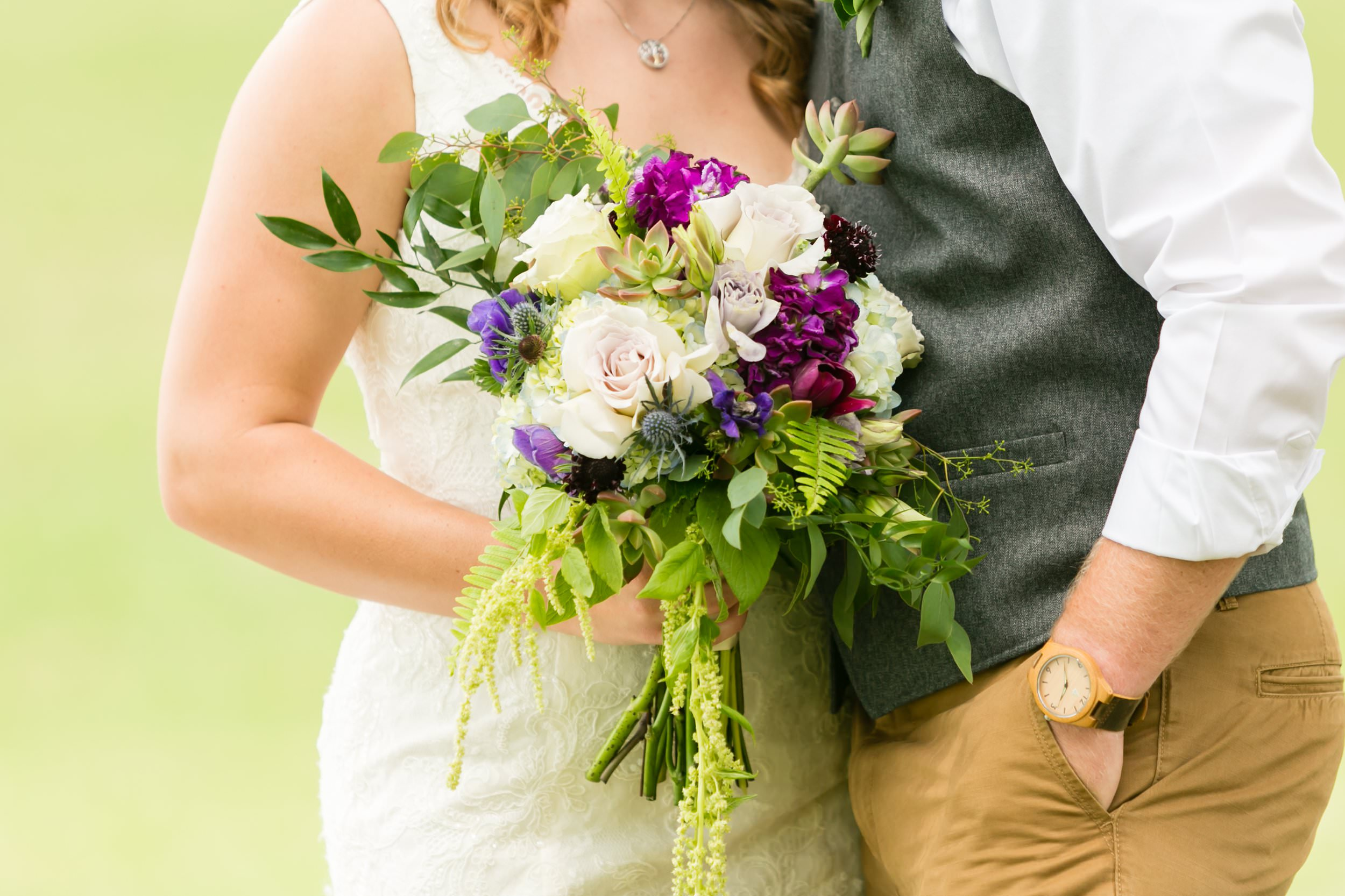 This purple, pink, and white bouquet was perfect for Douglas and Abigail's  rustic farm wedding at Abby Manor .