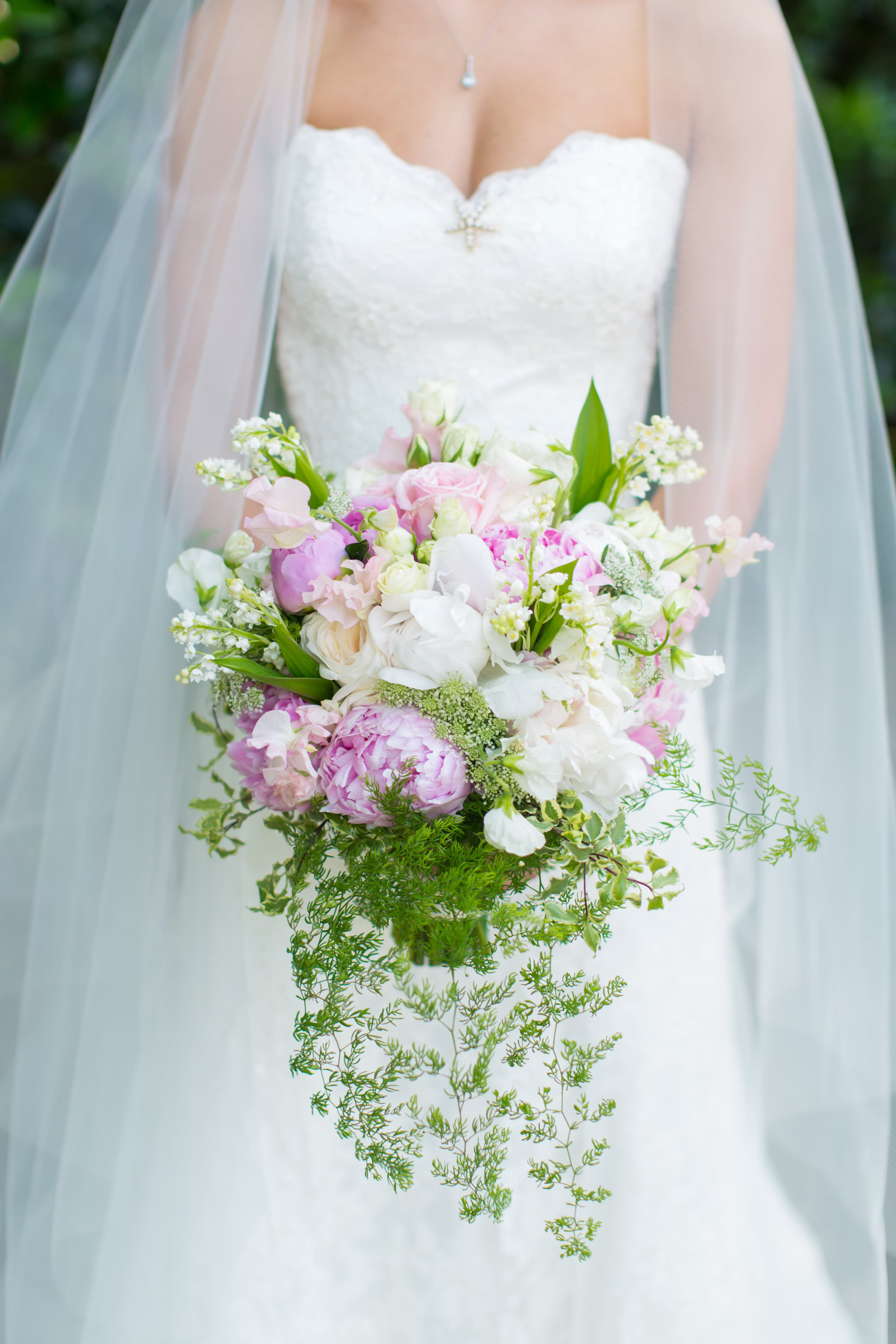 Annie's gorgeous bouquet by  Atlanta wedding florist Parties To Die For  was overflowing with color and texture!  Click here  to view more photos from Christian and Annie's  wedding at The Estate .