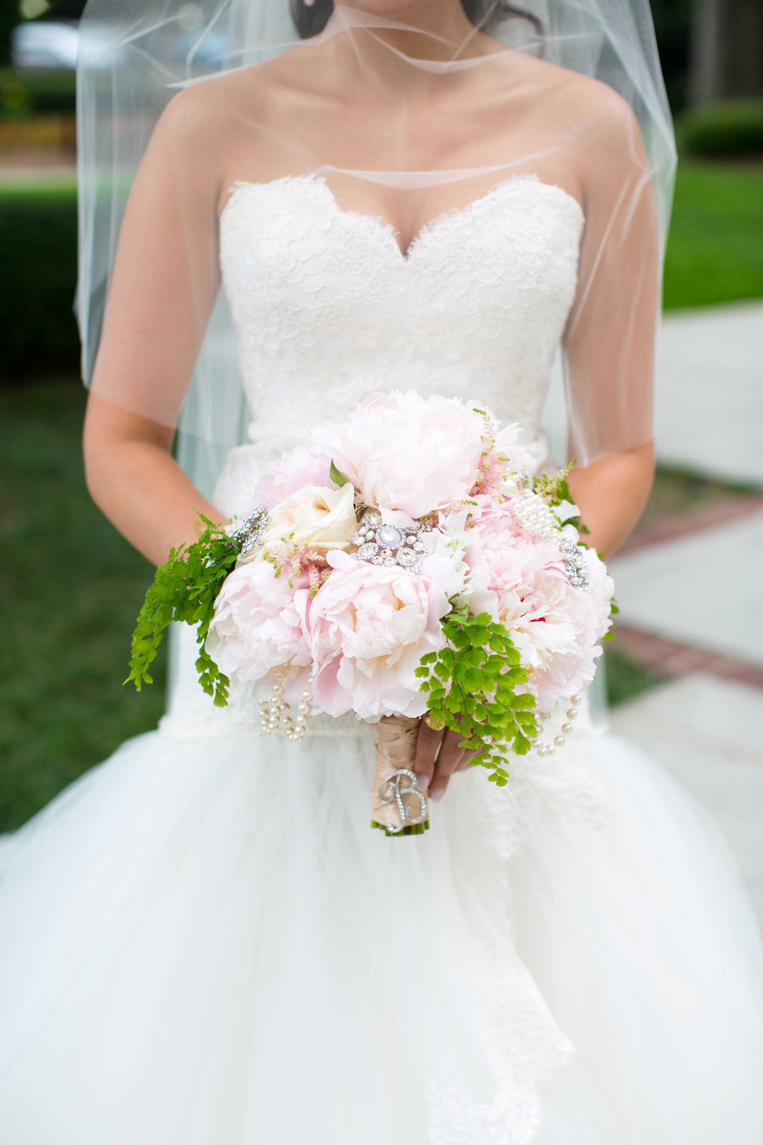 Liz's bouquet was all about the BLING! Rhinestone and pearl pins were mixed in with the peonies, making her bouquet one of the most stunning arrangements I've seen. And if you think her bouquet is beautiful, you have to see the arrangements at her  Biltmore ballrooms wedding here  and  here !