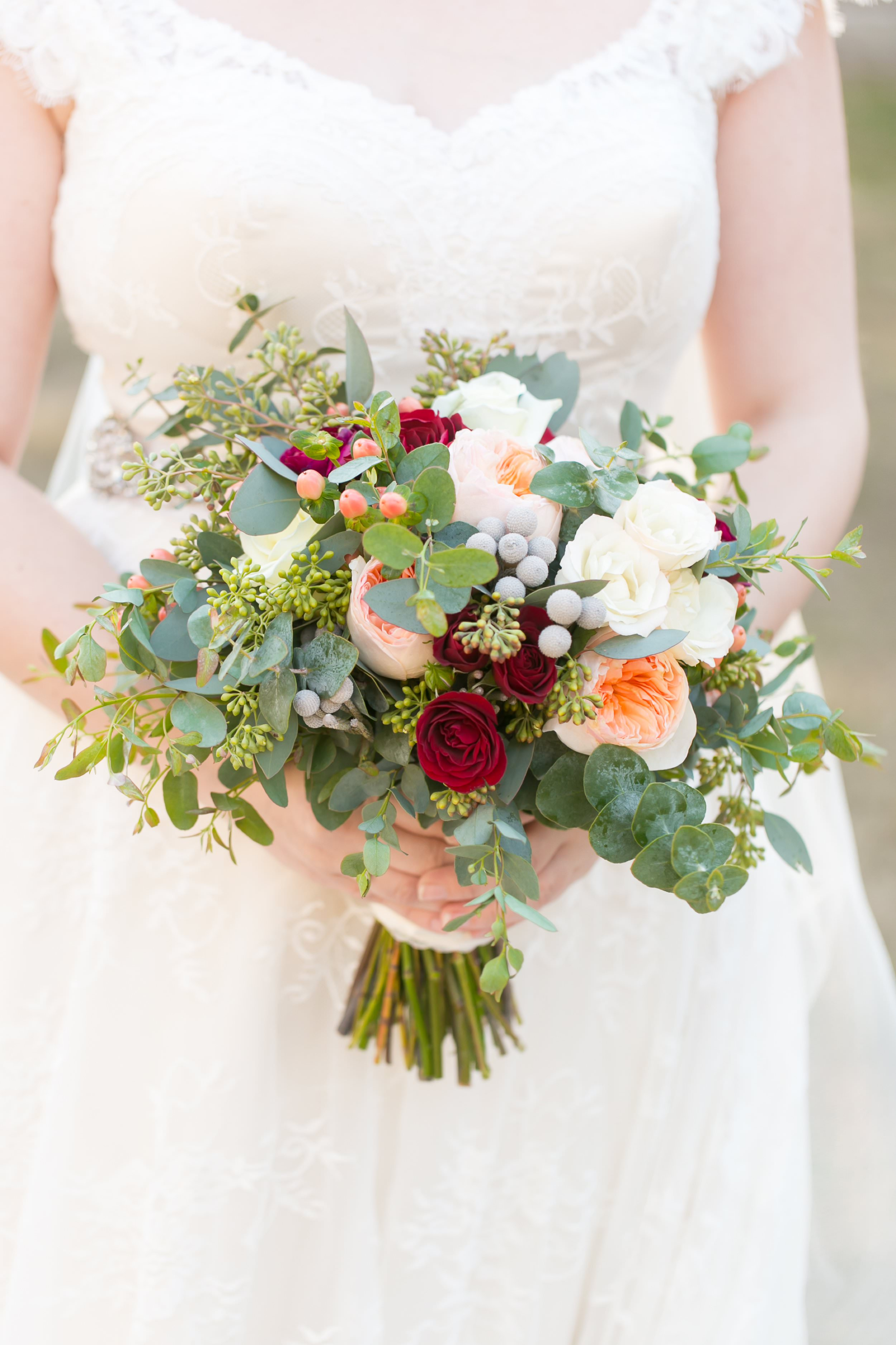 This delicate peach and green bouquet added a touch of warmth to Jason and Amanda's winter wedding.