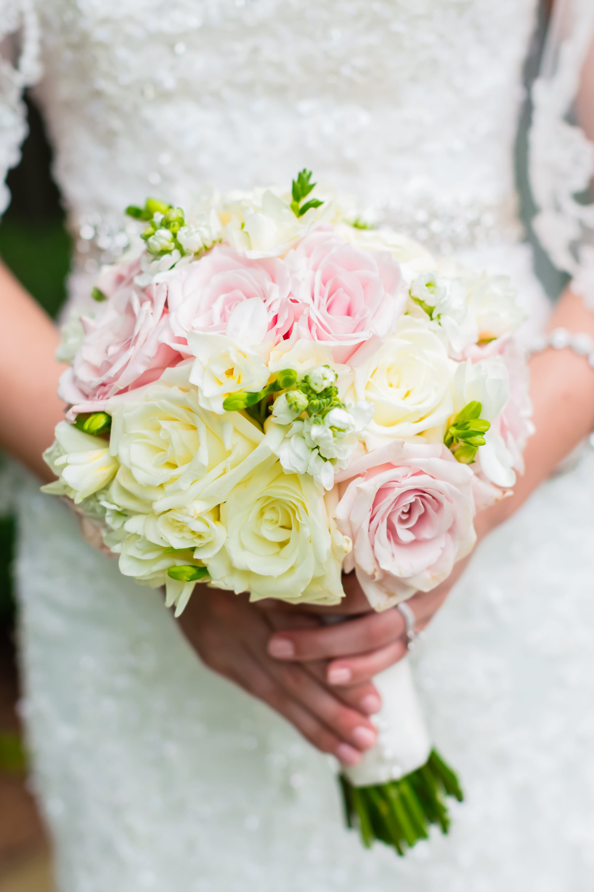 Melissa's pink and white bridal bouquet was designed by  Atlanta florist Unique Floral Creations . It brought a classic touch of color to her wedding design. To view more photos from Ben and Melissa's  Country Club of the South wedding, click here.
