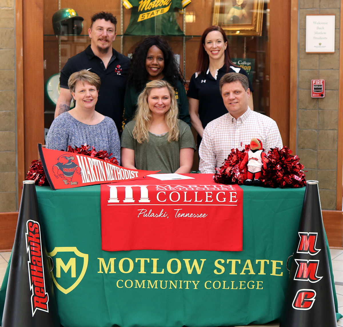 Joining Emily for the signing ceremony are, seated from left, Michelle Ray, mother; Emily Jordan Ray; and Cameron Ray, father. Standing from left, Micah Hartsfield, Martin Methodist head cheer coach; Bertha Smith, Motlow cheer coach/sponsor; and Monica Hartsfield, Martin Methodist head cheer/dance coach.