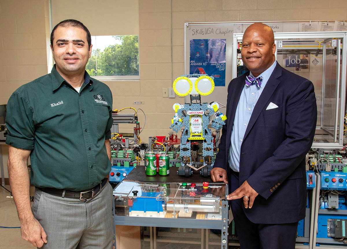 Dr. Khalid Tantawi, Motlow Mechatronics professor, and Dr. Michael Torrence, Motlow president, tour the mechatronics classroom at Motlow's McMinnville campus. Motlow, and Tantawi, were recently awarded a $545,000 grant from the National Science Foundation (NSF) for a project to introduce the concepts and technologies of Smart Manufacturing and Advanced Manufacturing. The project will feature Motlow as a national hub for training mechatronics educators across the nation.