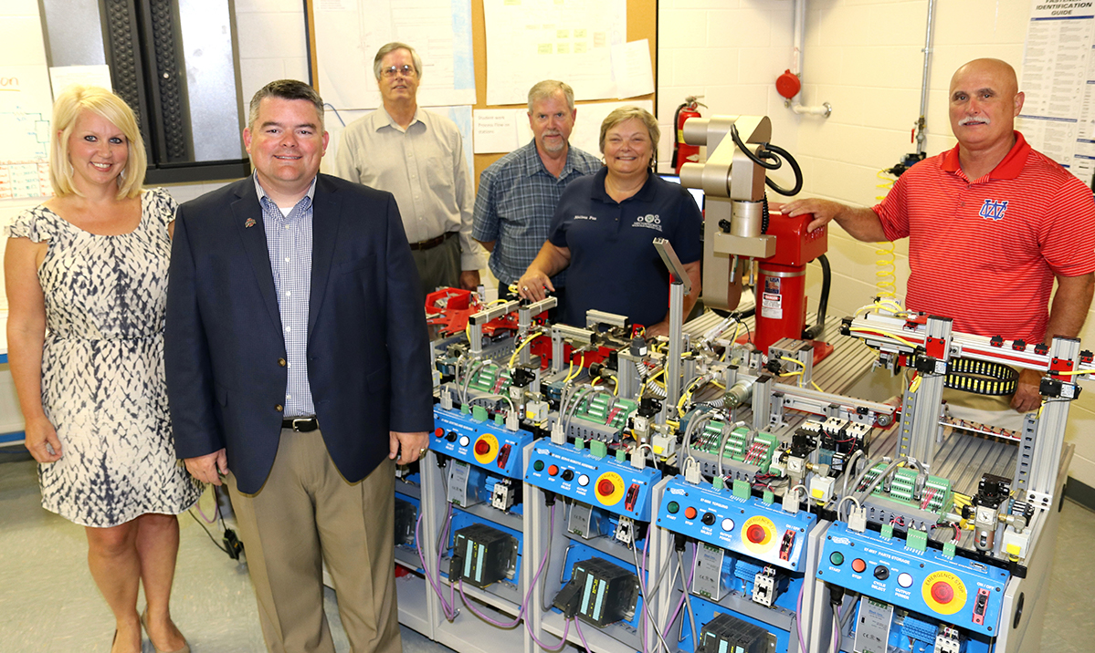 Motlow State Community College was recently awarded a $250,000 state grant to support its Middle College Mechatronics program at Warren County (McMinnville) and Oakland (Murfreesboro) high schools. Pictured in the mechatronics lab at Warren County High School, from left, are Sally Pack, Motlow administrator of high school initiatives; John Marshall, Oakland High School principal; Fred Rascoe, Motlow dean of career and technical programs; Charlie King, Motlow mechatronics instructor; Melissa Paz, Motlow mechatronics instructor; and Jimmy Walker, Warren County High School principal.