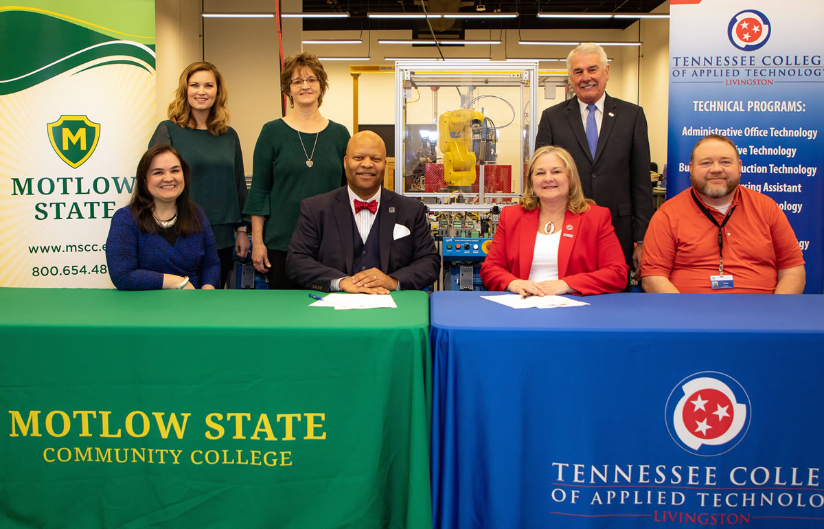 Motlow and Tennessee College of Applied Technology (TCAT) Livingston recently entered into an articulation agreement that will facilitate TCAT Livingston students transferring to Motlow. Pictured at the agreement signing in Livingston this past spring, seated from left: Melody Edmonds, assistant vice president of academic affairs; Dr. Michael Torrence, Motlow president; Dr. Myra West, TCAT Livingston president; and Scott Gaw, TCAT industrial maintenance instructor. Standing from left: Beth Ann Swallows, Motlow Sparta Teaching Site coordinator; Gina Burke, Motlow business and technology curriculum chair; and Gary Morgan, Motlow Foundation chair. Motlow Staff Photo.