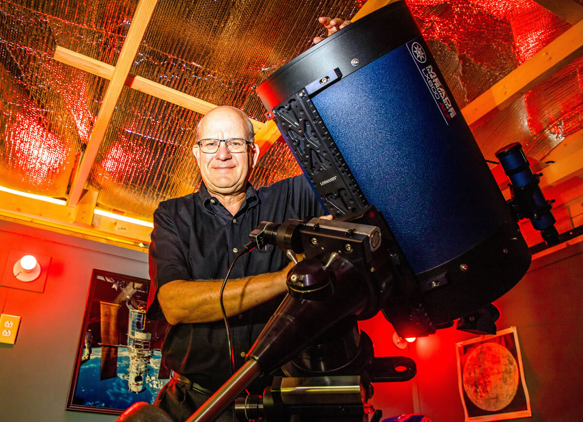 """Billy Hix, pictured inside his personal observatory located near his home in Shelbyville, is about to start a night under the stars. Hix, who calls the observatory his """"happy place,"""" loves the peace that comes with being alone under the stars, but often has student groups to enjoy the views as well. Motlow Staff Photo."""