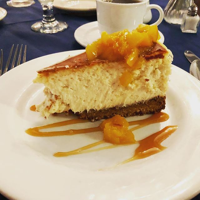 Cheesecake with moonshine-soaked peaches. #yesplease #moonshine #dessertmyheart