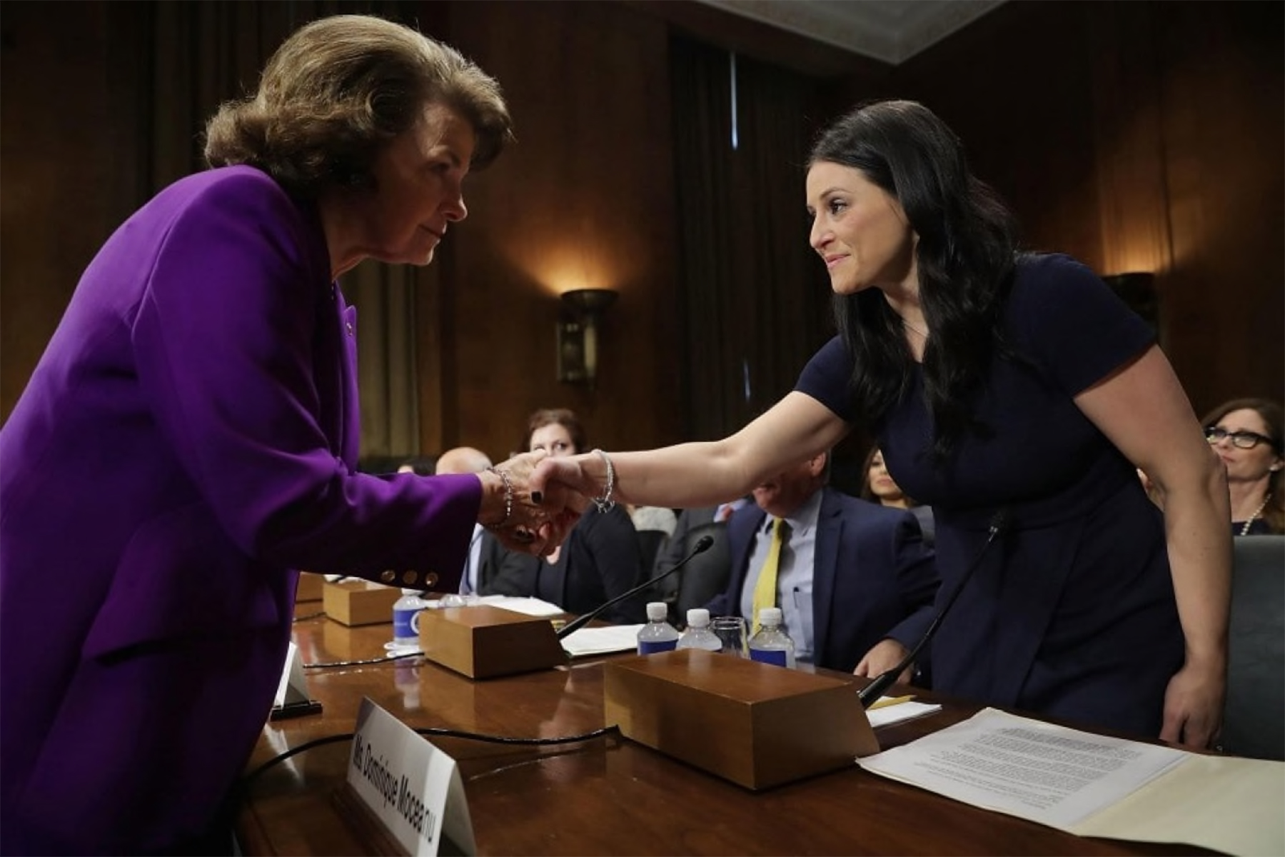 Sen. Dianne Feinstein greeted 1996 Olympic gold medalist Dominique Moceanu before she testified to a committee about sexual, emotional and physical abuse by USA Gymnastics on March 28. (Chip Somodevilla/Getty Images)