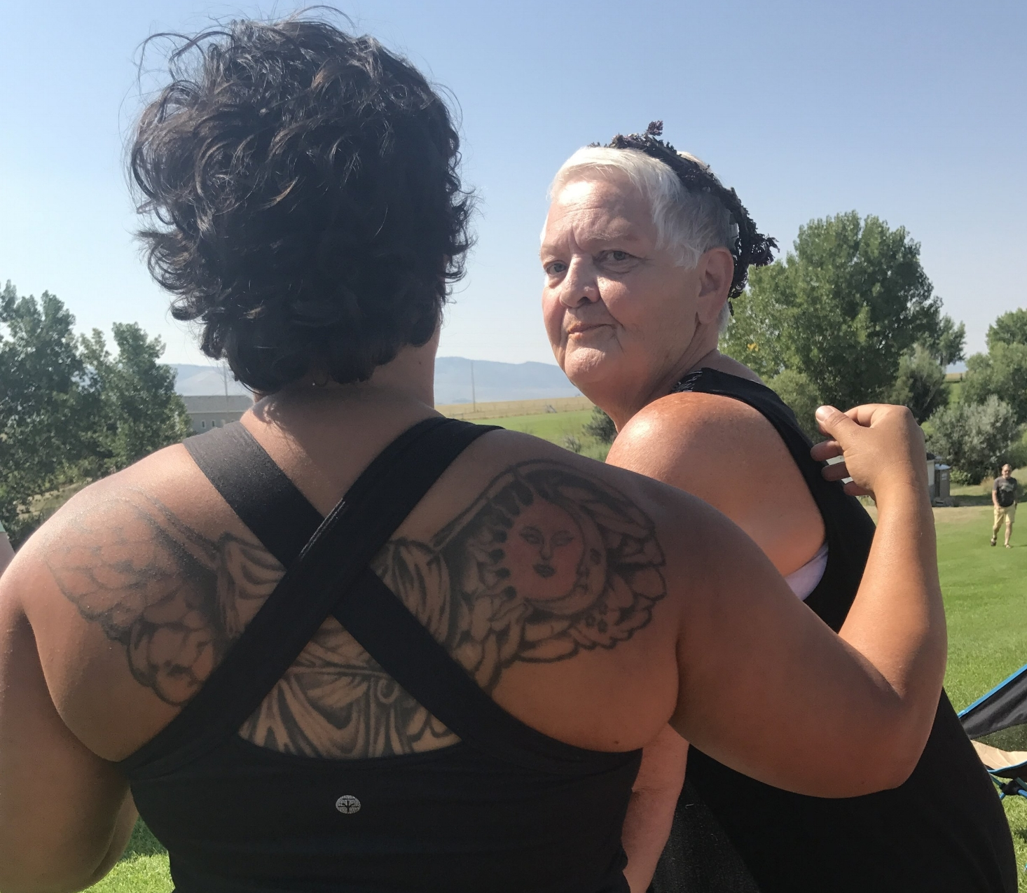 Kia with the eclipse tattoo and Becky's Mom, in whose backyard we camped.