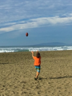 Playing catch on the beach with his dad the day after Thanksgiving - much more fun than shopping!