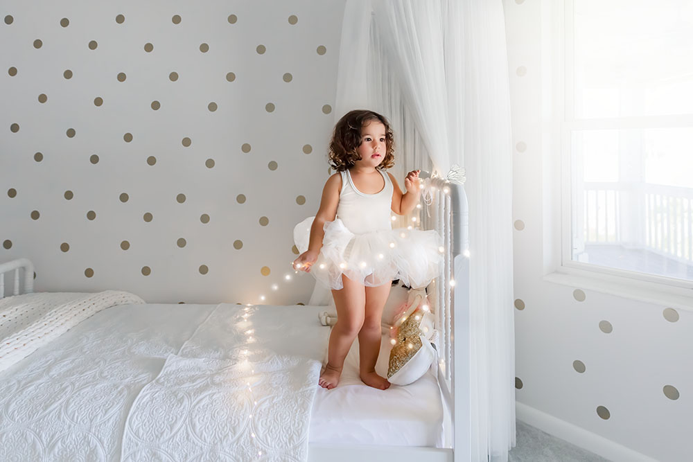 Part of the bright and airy feel is the light colored clothing, and environment. Also light and airy needs light and here she is beside a window and glass door.