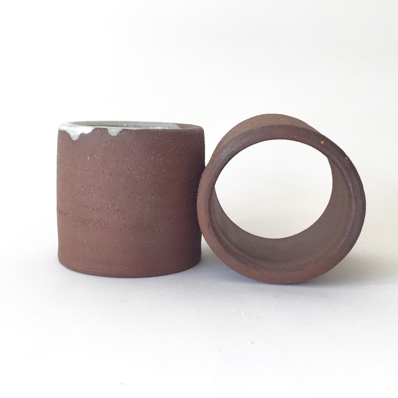 """Infinity White  Wheel-thrown. Glaze on chocolate stoneware. 4""""H x 4""""W x 8""""L Wholesale 34"""
