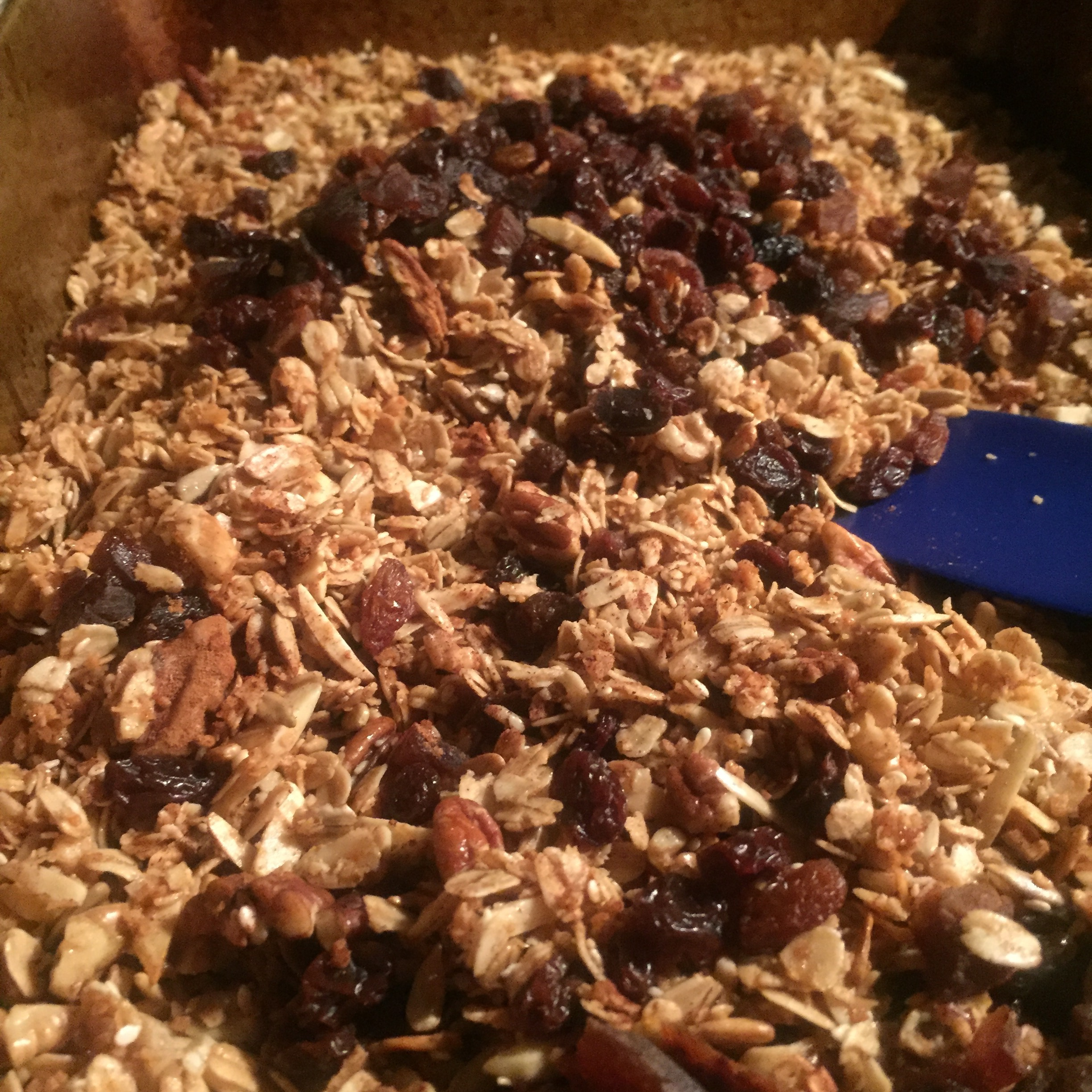 Mix & let cool. - Transfer the granola to another baking sheet or heat proof surface to stop the cooking process (simply lift the granola off the baking sheet using the parchment overhang).Toss the granola with a spatula and mix with 1 cup of dried fruits (such as cranberries, raisins, cherries, chopped apricots, currants, etc. Use your favs!)Spread/press into an even layer, then let cool to room temperature. If stuck together, break the granola into clusters and store in an airtight container.