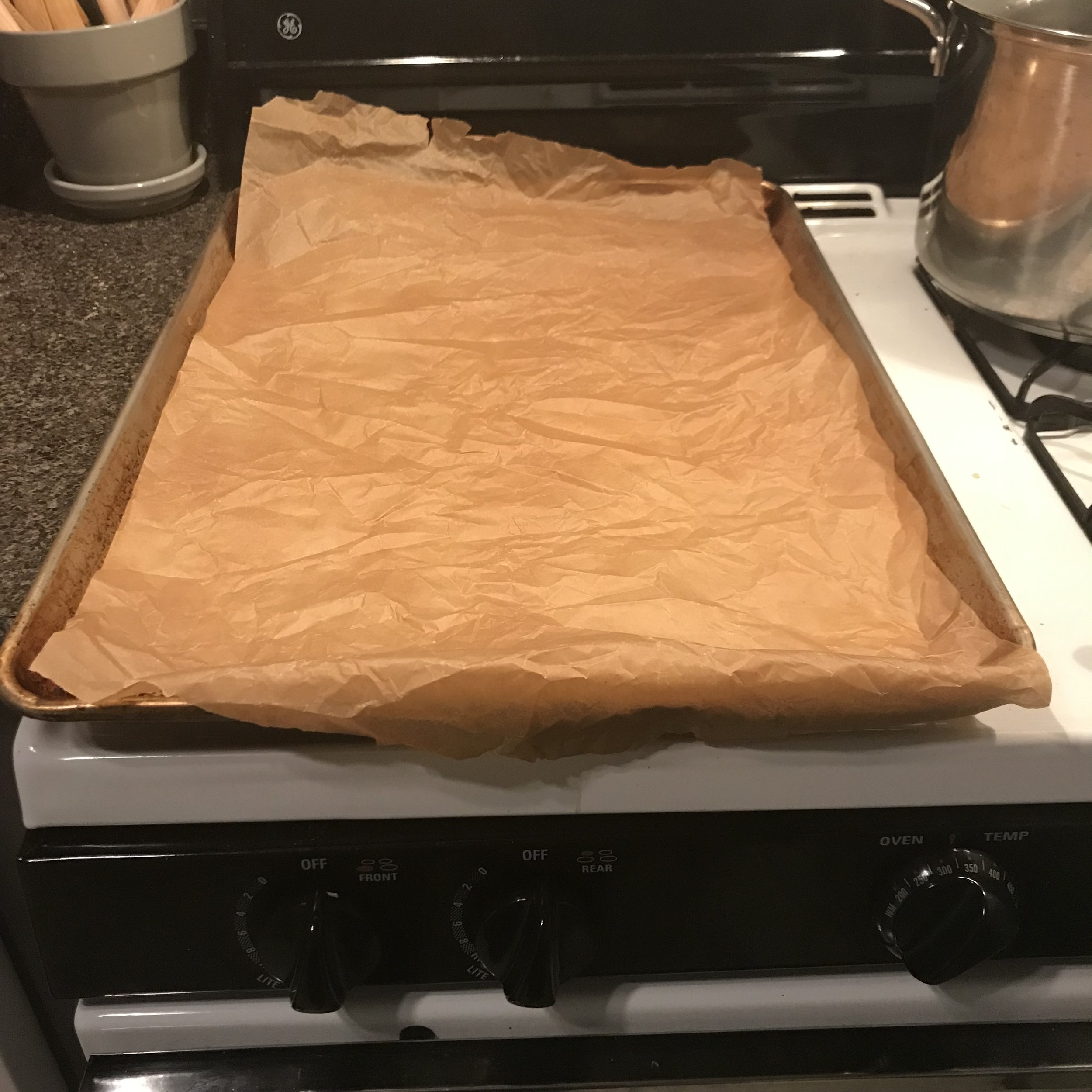 Preheat your oven. - Preheat the oven to 325°F.Line a 13 x 18-inch rimmed baking sheet with (crumpled) parchment paper.