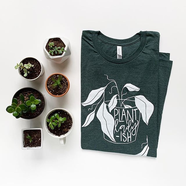 My props are hashtag living for the weekend. But most significantly, they are living. 🌱 Whether your plants are omg liiiiterally dying or living their best lives, this shirt is a super comfy reflection of your deep desire to nurture your green-ish friends.