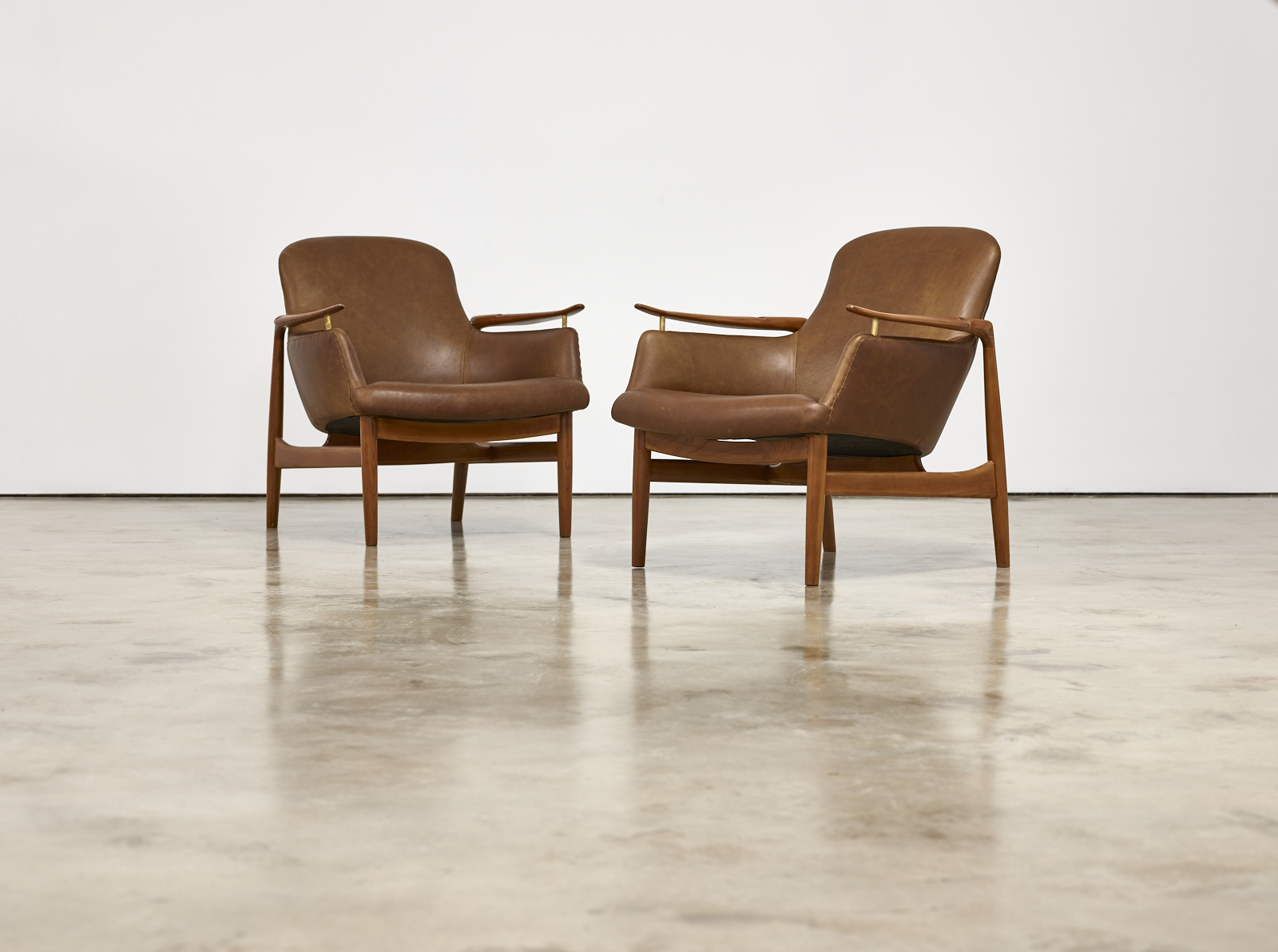 Click here for the 1950s Finn Juhl by Niels Vodder NV53 Armchairs