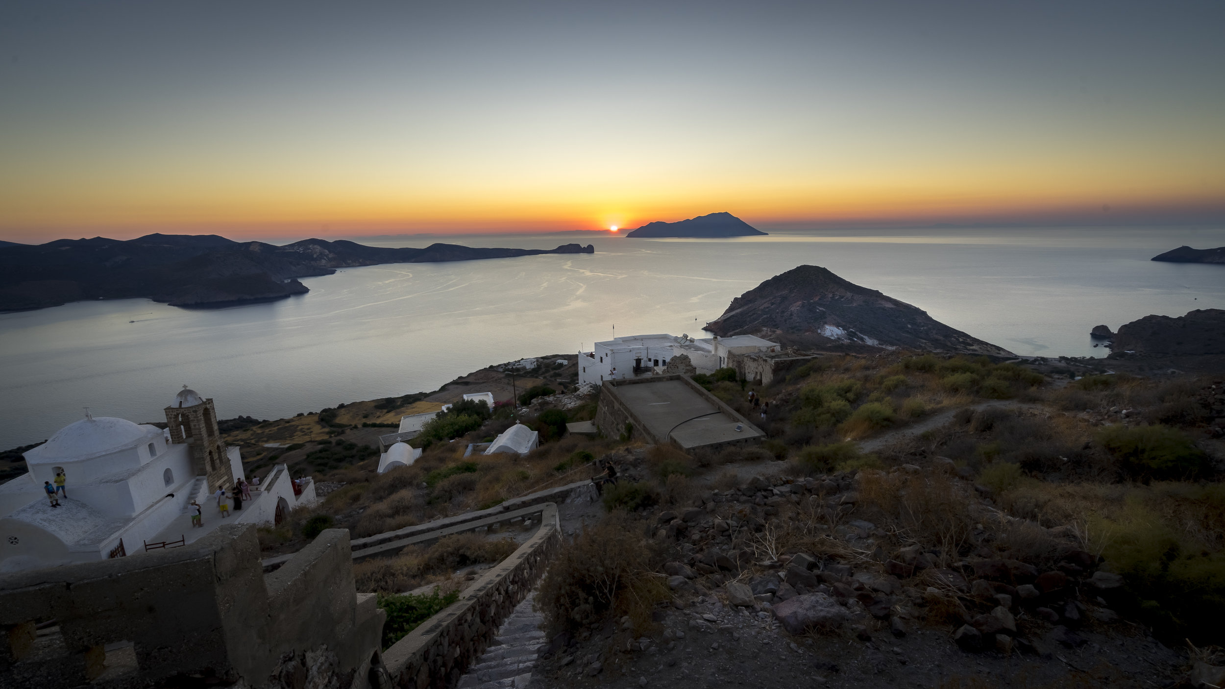 Santorini eat your heart out.This is one of the most popular places to take in the sunset up on the top of one of one of the islands highest points in an old ruined castle. You almost certainly won't be alone and there will be cheering when the sun sets.