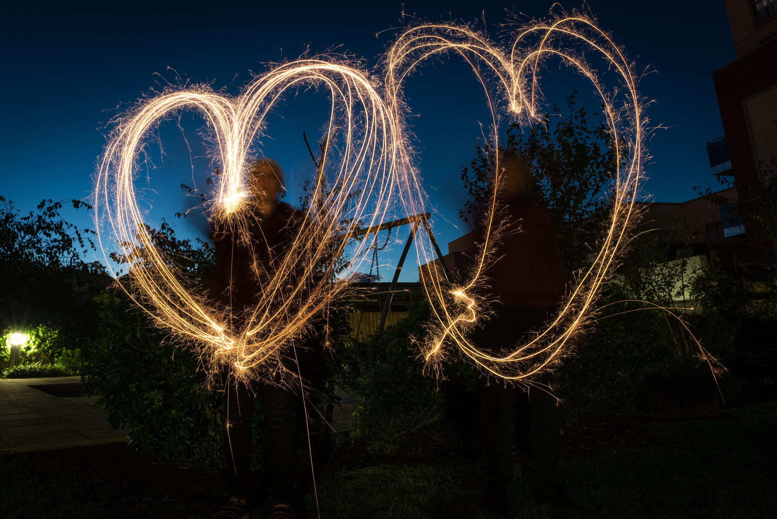Both of us drawing hearts.