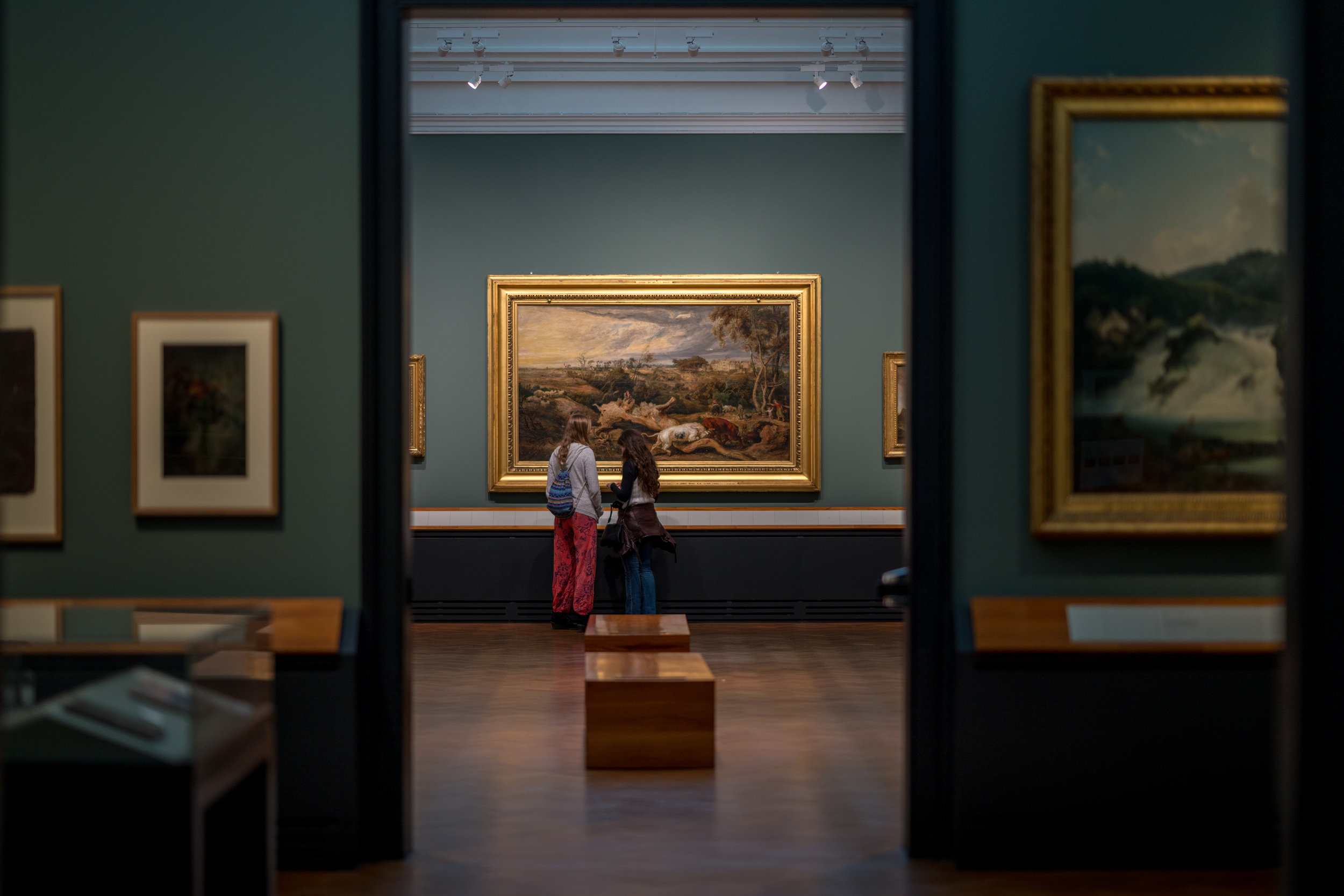 To people admiring a famous work of art.  85mm f1.4 iso 320 1/100