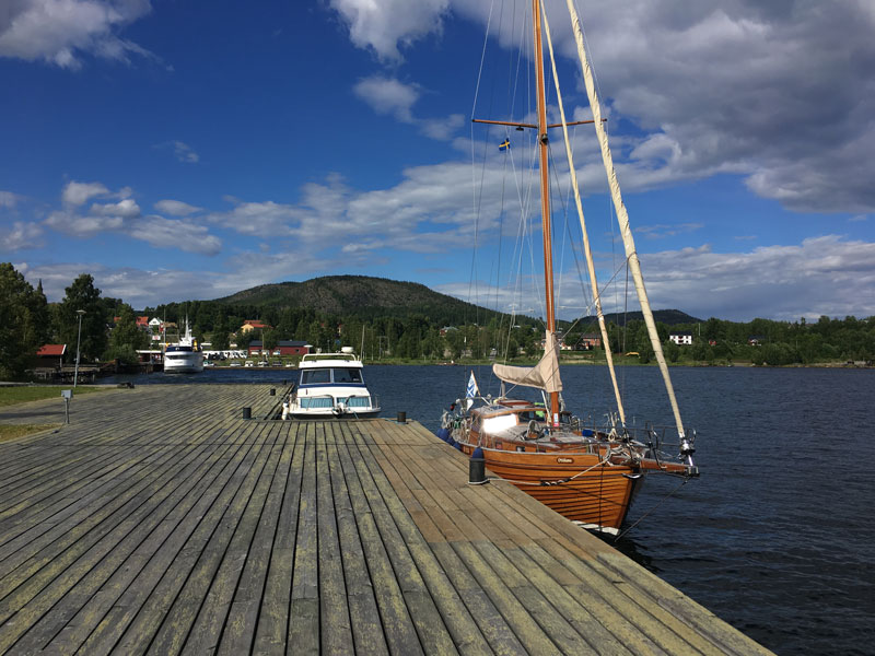 S/Y Ottiliana moored at Docksta Havet Base Camp with on background the Skuleberget