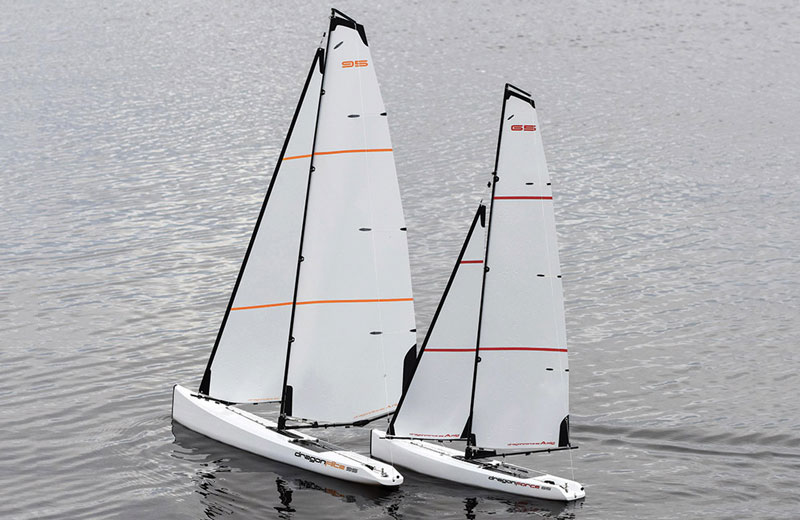 A Dragon Force 95 and a 65 sailing on a broad reach in calm waters.