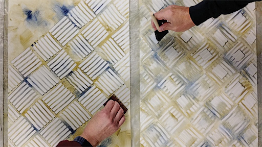 Teamwork came in handy to produce multiple paste paper sheets with the same complicated pattern.