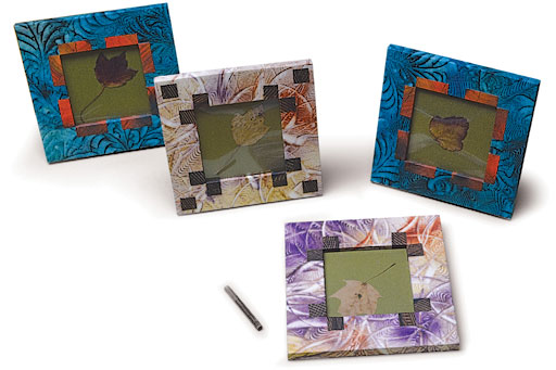 ⬆ IDEA : Wrap a simple picture frame first in one paste paper design and then accent it with a second contrasting one.