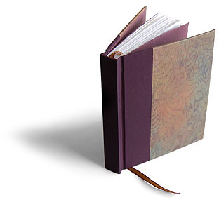 One-of-kind paste paper, cotton paper pages with hand torn edges and a ribbon marker make this book a special keepsake.