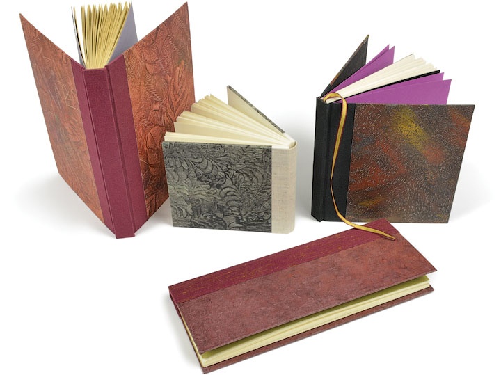 ⬆ At Lead Graffiti, our main interest in making paste paper is for covering books like those shown here.