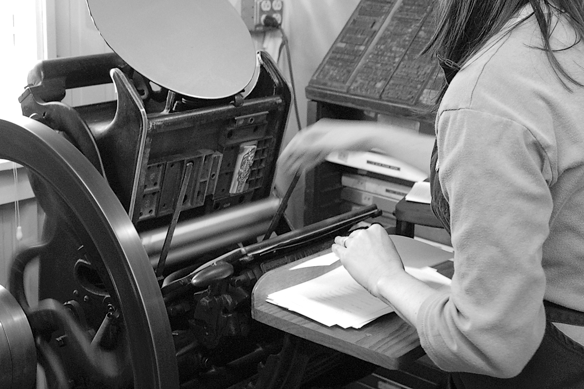 Hand feeding and removing the paper from a motorized floor-model platen is a dance between your hands focused on timing.