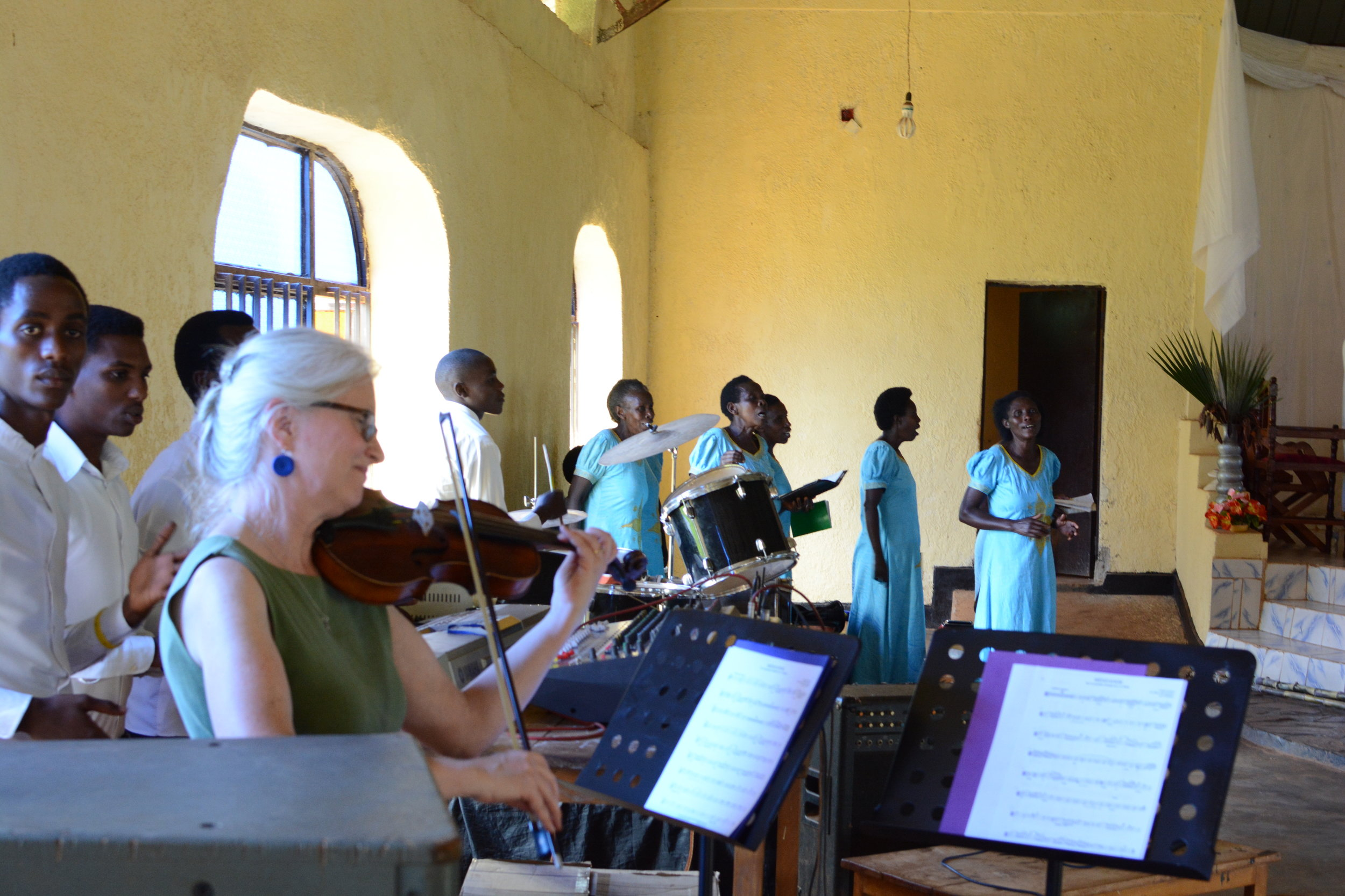 Terri Moon accompanying the singing on violin